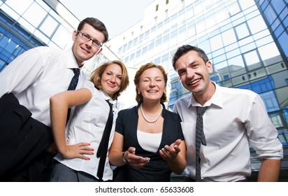 Happy office workers stay across building