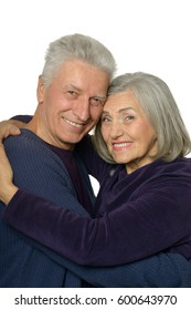 Happy old couple embracing on a white background