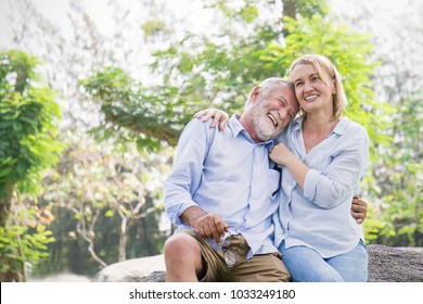 Happy old elderly caucasian couple smiling in a park on a sunny day, hoot senior couple relax in the forest spring summer time. Healthcare lifestyle elderly retirement together valentines day concept