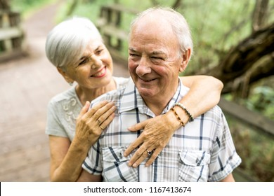 Happy old elderly caucasian couple in a park