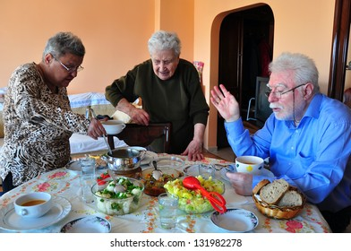 a happy old family having dinner together