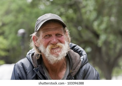 Happy old homeless man smiling