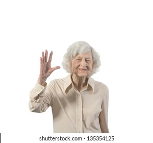 Happy old lady waving. Isolated with copy space.
