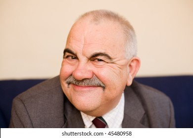 Happy old man content with life, his savings and his retirement
