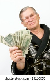 Happy old man holding dollars. Isolated