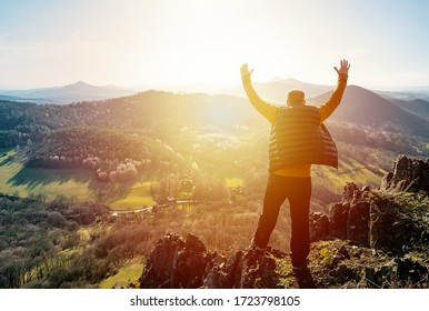 Happy old man just reaches the top of hill. Handsome senior to the mountain top against backdrop of sunset. Valley watching sunset in last sun rays. Discovery, Travel, Adventure