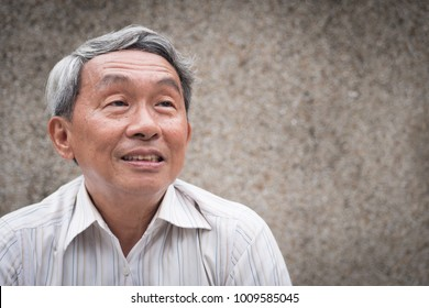 happy old man looking up, smiling senior thinking, positive retired pensioner portrait