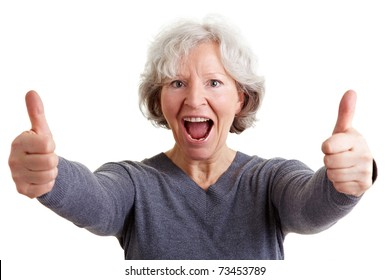 Happy old senior woman holding both thumbs up