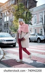 Happy old woman walking in town