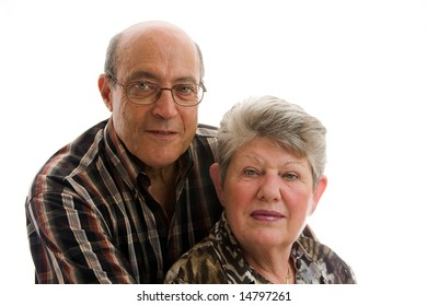 Happy older couple sitting together, isolated