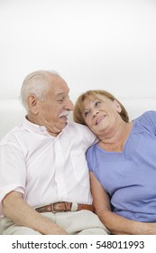 Happy older couple still in love and being playful