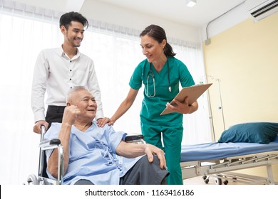 happy older patient on wheelchair with son and Caring doctor or male nurse smiling spending time together,about medic consultation on nursing home or hospital while spending morning,healthcare concept