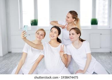 Happy Optimistic Pregnant Women Sitting On Fitballs Taking Photo On Smartphone, Posing