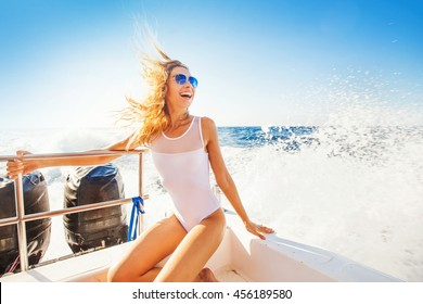 happy overjoyed woman on a boat