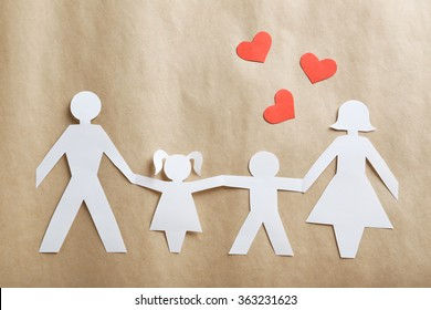 Happy paper family on paper background