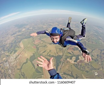 Happy parachutist smiling in freefall