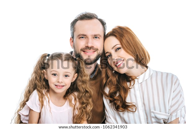 happy parents with adorable little daughter smiling at camera isolated on white