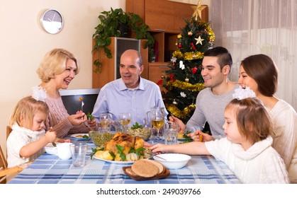 happy parents with adult kids and grandchildren celebrating xmas