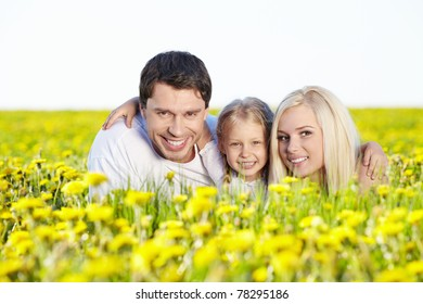 Happy parents with a child outdoors