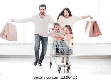 happy parents with children go shopping