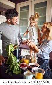 Happy parents giving to daughter healthy breakfast