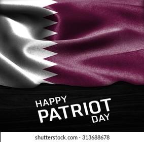 Happy Patriot Day Qatar flag on wood Texture background