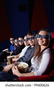 Happy people in 3D glasses at the cinema