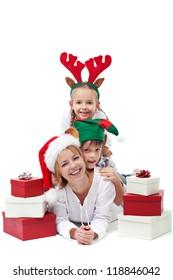 Happy people with christmas hats among presents - isolated