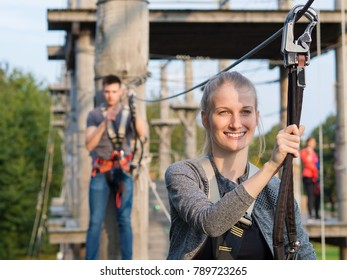 happy people climbing at high rope garden