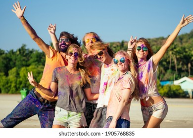 happy people in colorful holi paint play on beach on festive in Goa beach India