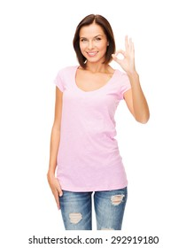 happy people concept - smiling woman in blank pink t-shirt showing ok gesture