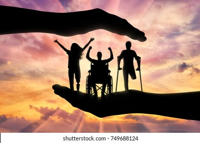 Happy people with disabilities in the hands, under the protection and tutelage. The concept of assistance and protection of the rights of persons with disabilities