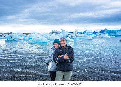 Happy people enjoy Ice Lagoon. Iceland, relax concept picture
