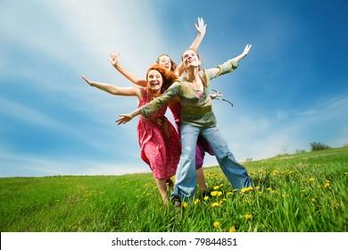 Happy people in field