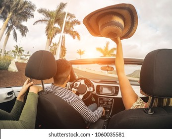 Happy people having fun in convertible car in summer vacation - Young friends laughing on cabrio auto outdoor - Main focus on man head - Travel, youth lifestyle, holidays and friendship concept