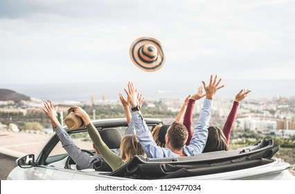 Happy people having fun in convertible car in summer vacation - Young tourist friends traveling in cabriolet auto - Youth lifestyle, travel and friendship concept - Main on right man head