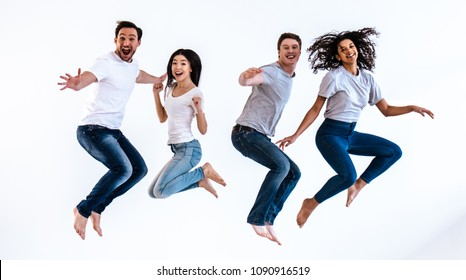 The happy people jumping on the white background