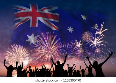 Happy people are looking holiday fireworks with flag of Australia in sky, independence day