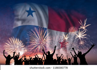 Happy people are looking holiday fireworks with flag of Panama in sky, independence day