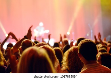 Happy people at  Music Concert, festival, clapping, singing raising their hands
