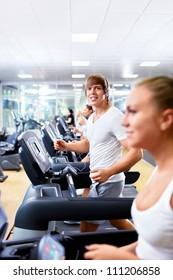 Happy people on treadmills