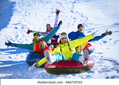 Happy people on a tube outdoors