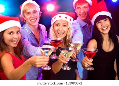 Happy people in santa hat clinking by glases with you