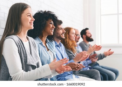 Happy People Sitting In Row Applauding To Mentor At Therapy Session Group Meeting
