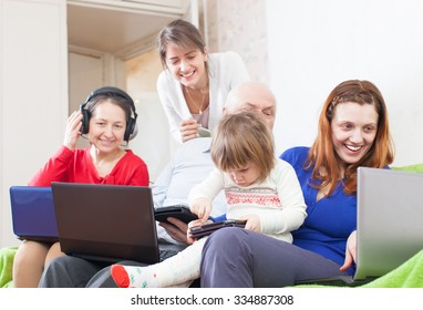 happy people  uses few various  devices at home