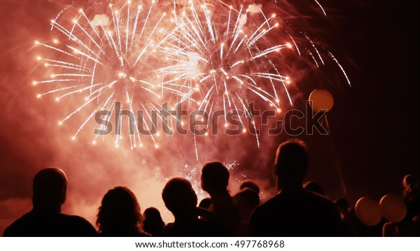 Happy people watching fireworks