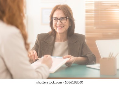 Happy personal coach presenting counseling services to a corporate employee