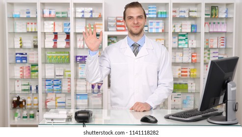 Happy Pharmacist Specialist American Man Saluting Hand Gestures in Pharmacy Shop or Drugstore Interior, Pharmaceutical Store Concept