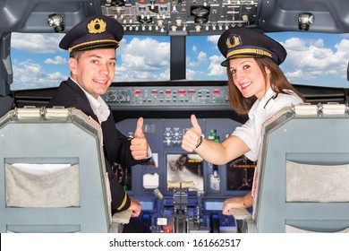 Happy Pilots in the Cockpit with Thumbs Up