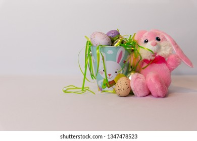 Happy pink easter bunny and eggs
